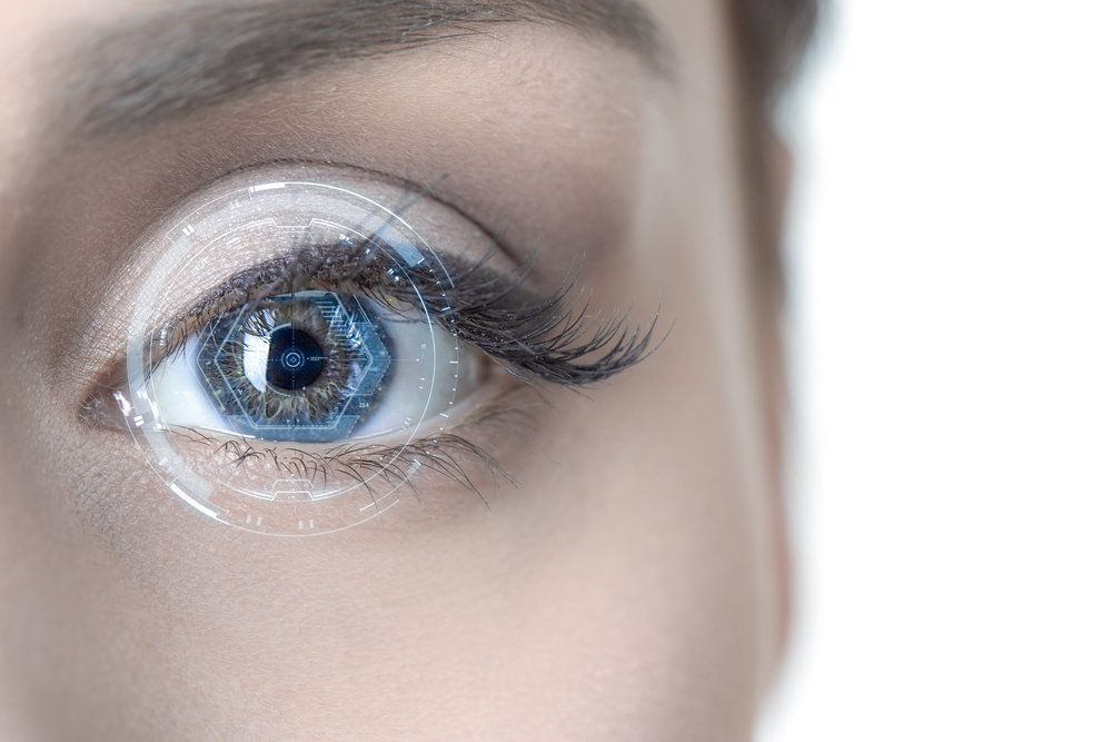 A laser honed in on a patient's eye in preparation for LASIK surgery