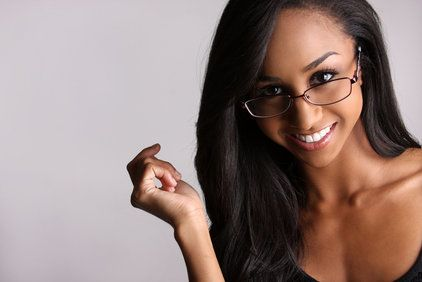 Woman in glasses smiling coyly
