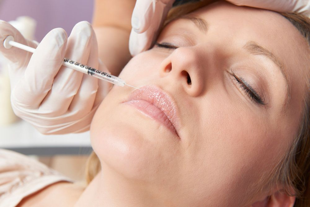 A woman getting a dermal filler injection
