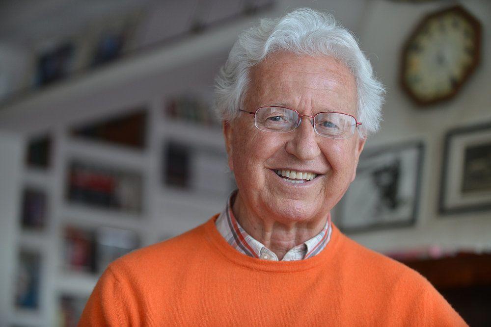 An elderly man wearing eyeglasses