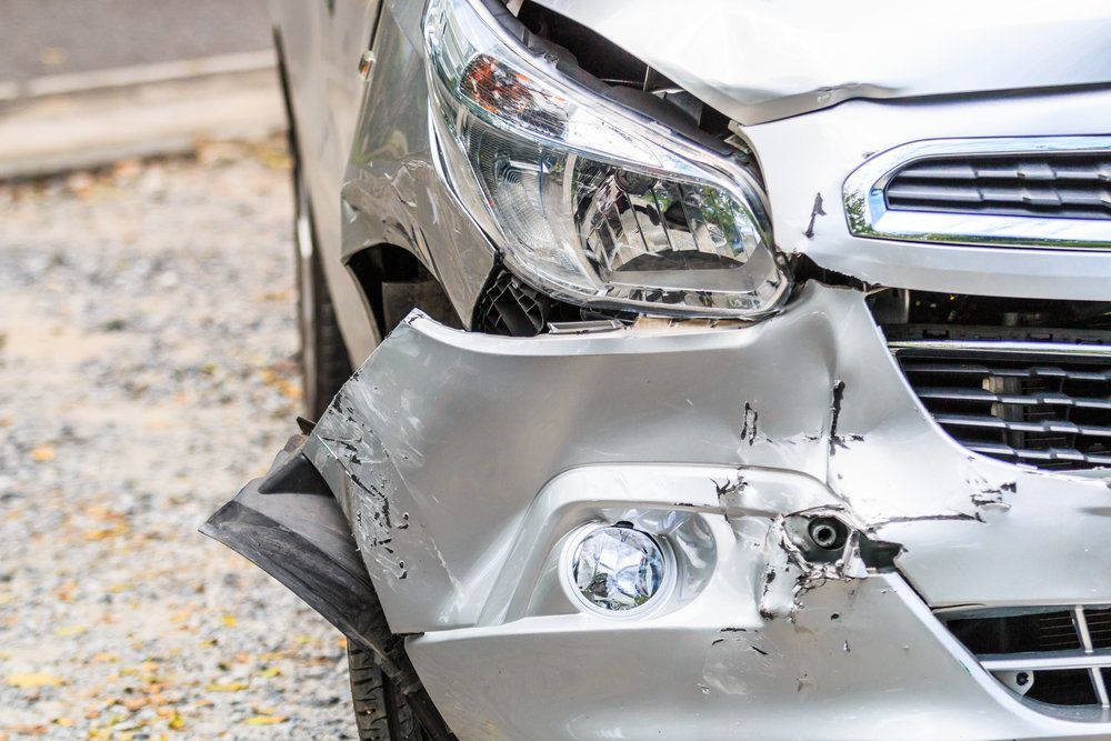 The front bumper of a car after an auto accident