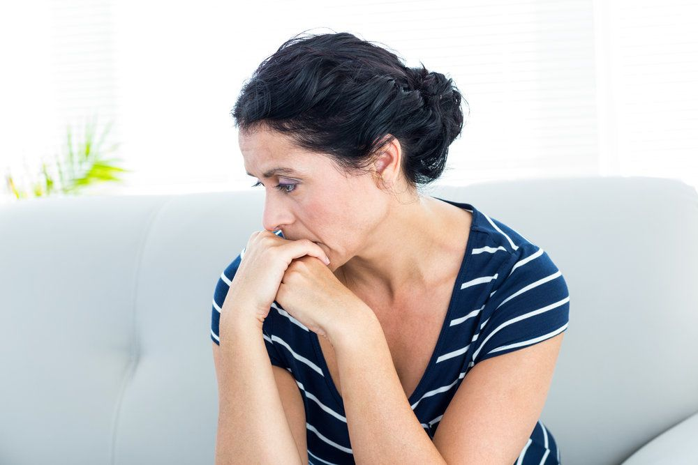 A woman looking forlorn due to her fertility problems caused by fibroids