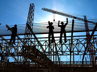 An outdoor shot of construction workers toiling in the hot sun.