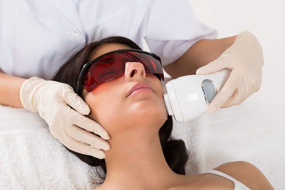Photo of woman receiving laser treatment