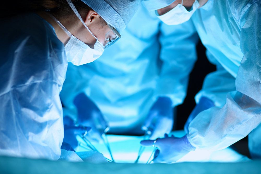 A surgeon in an operating suite