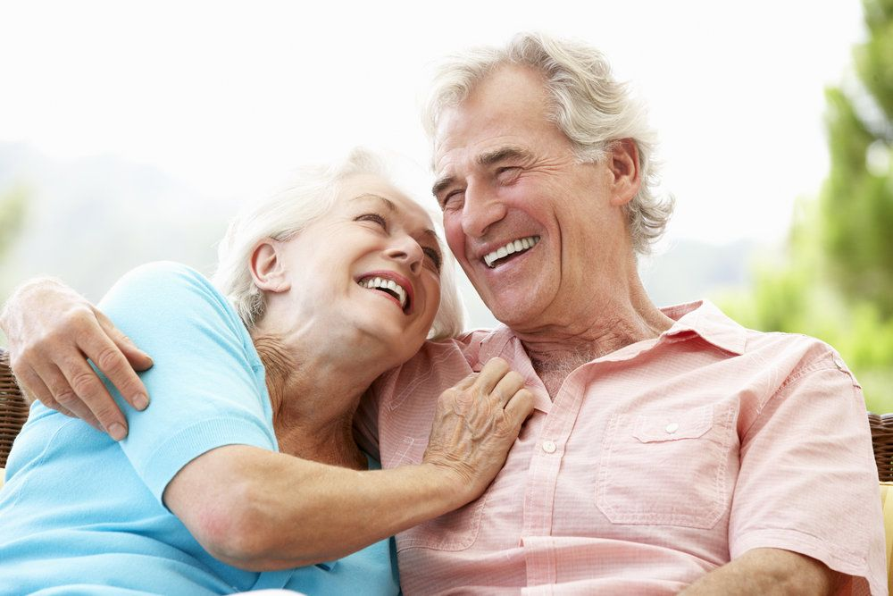 An older couple together smiling