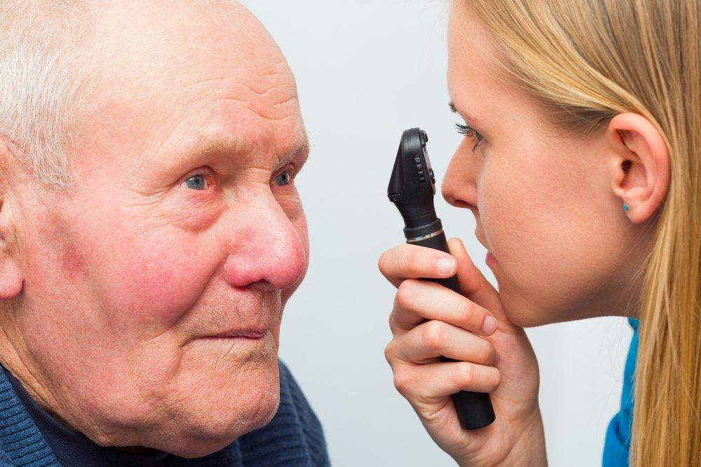 Senior man having his eyes examined