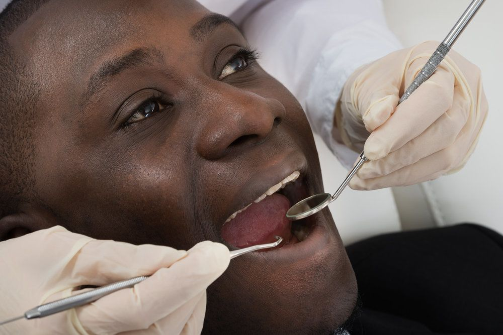 A man undergoing a dental exam to diagnose tooth pain