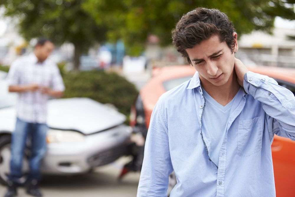 Male holding his neck in pain after an auto accident