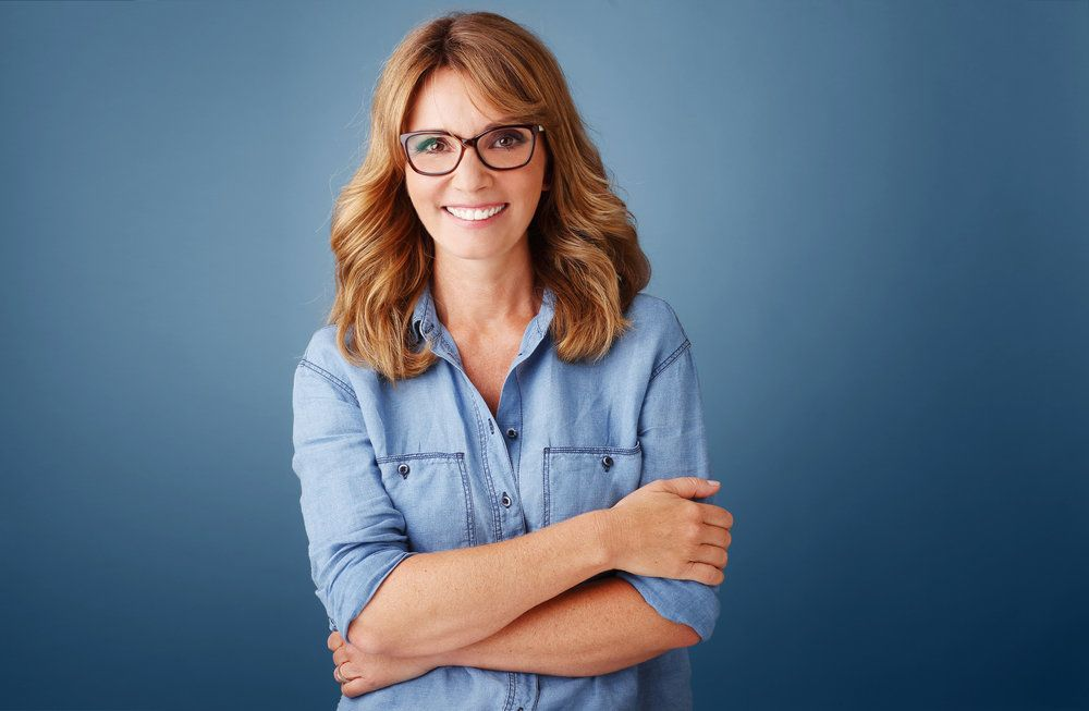 A woman wearing reading glasses