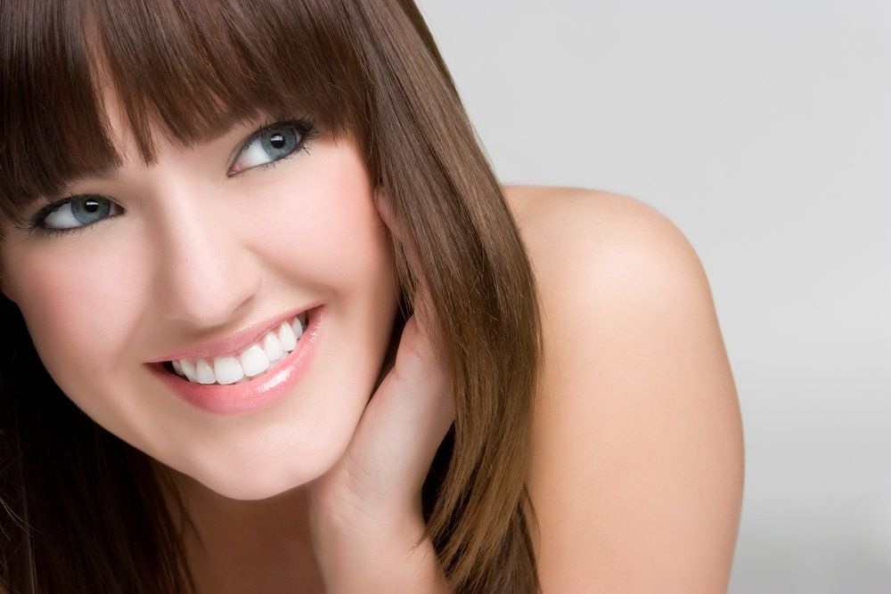 A woman with bangs smiling