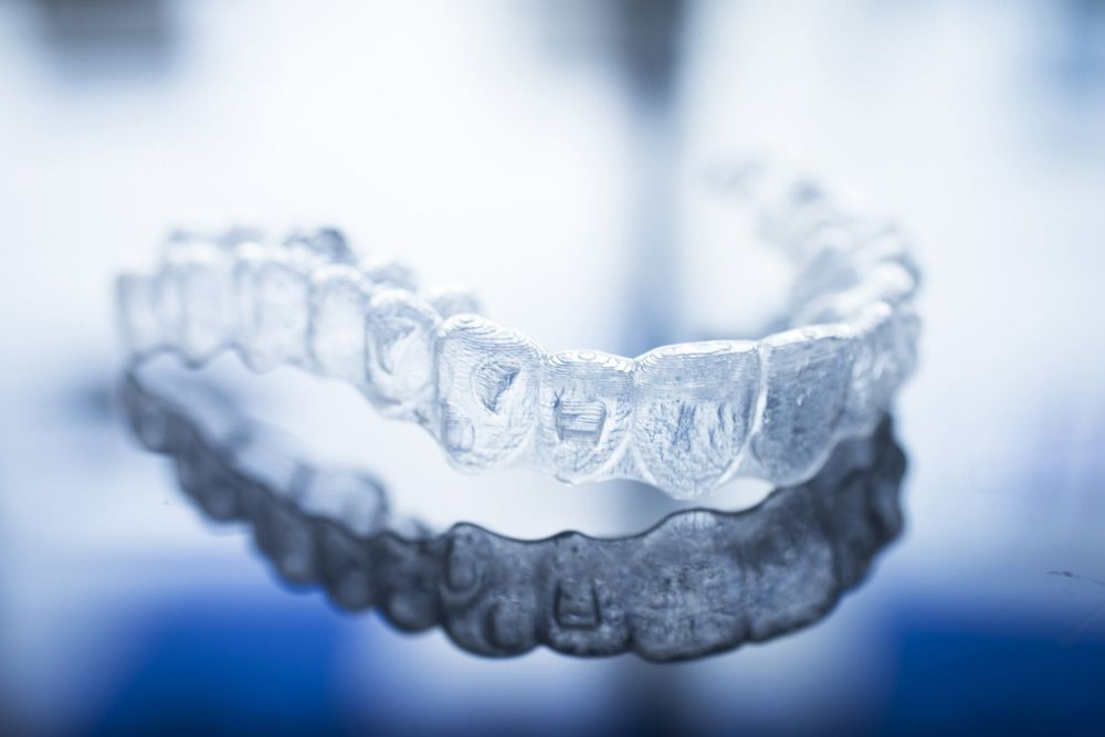 Invisalign tray on reflective gray surface