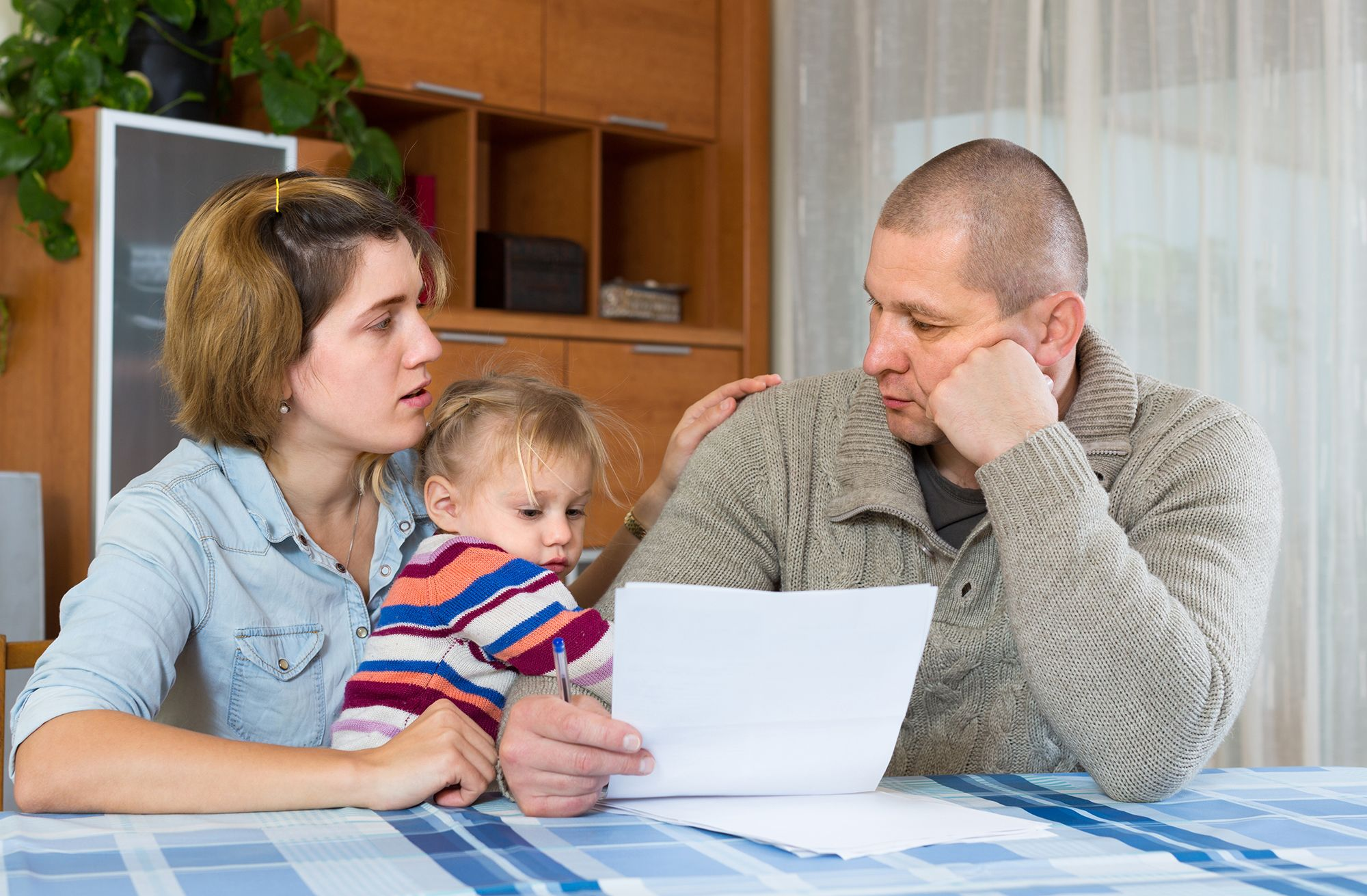 A family going over paperwork