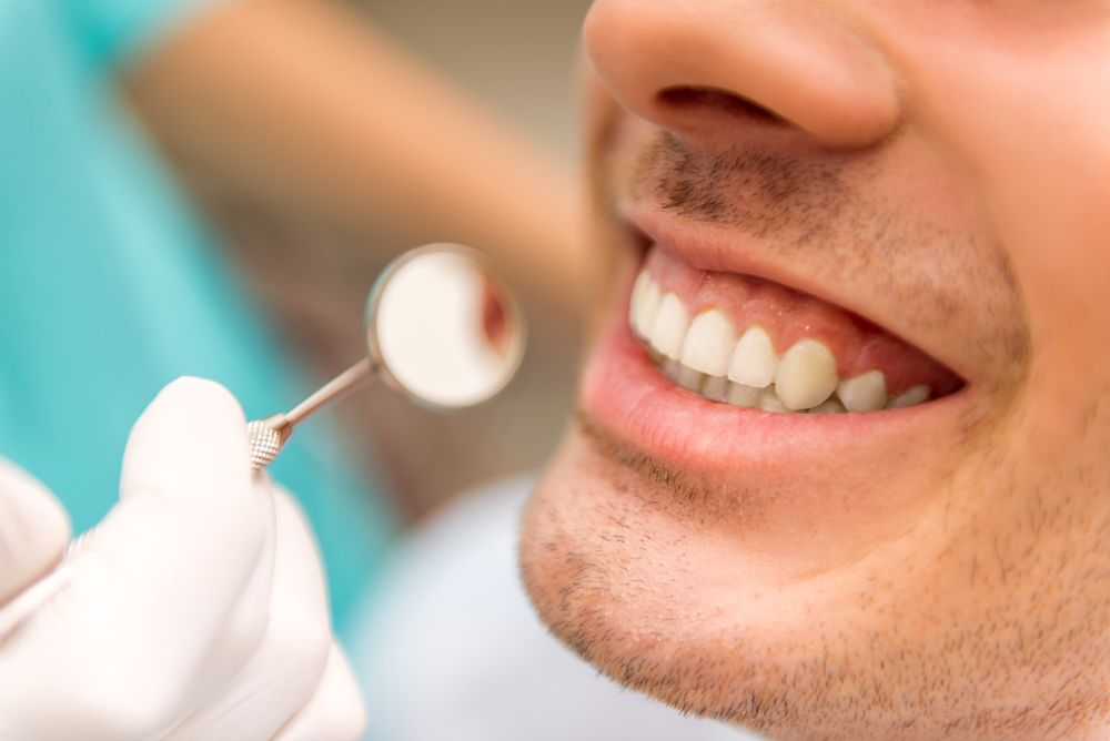 Up close photograph of a man having dental exam