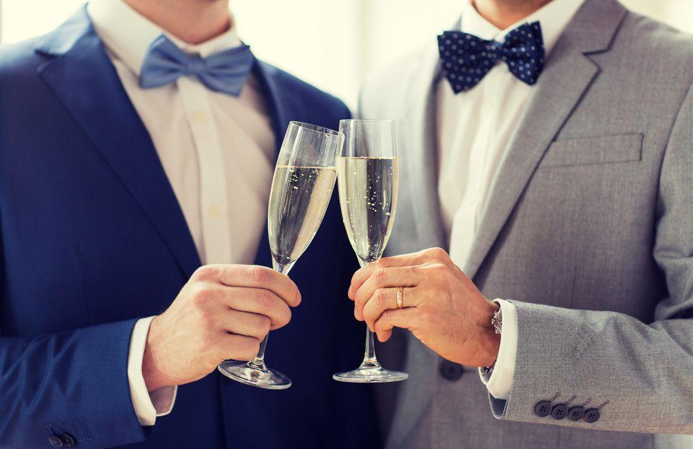 Two men toasting their marriage