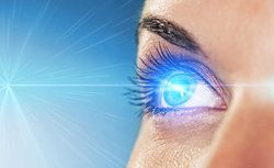 Caucasian woman with bright light reflecting in her eye