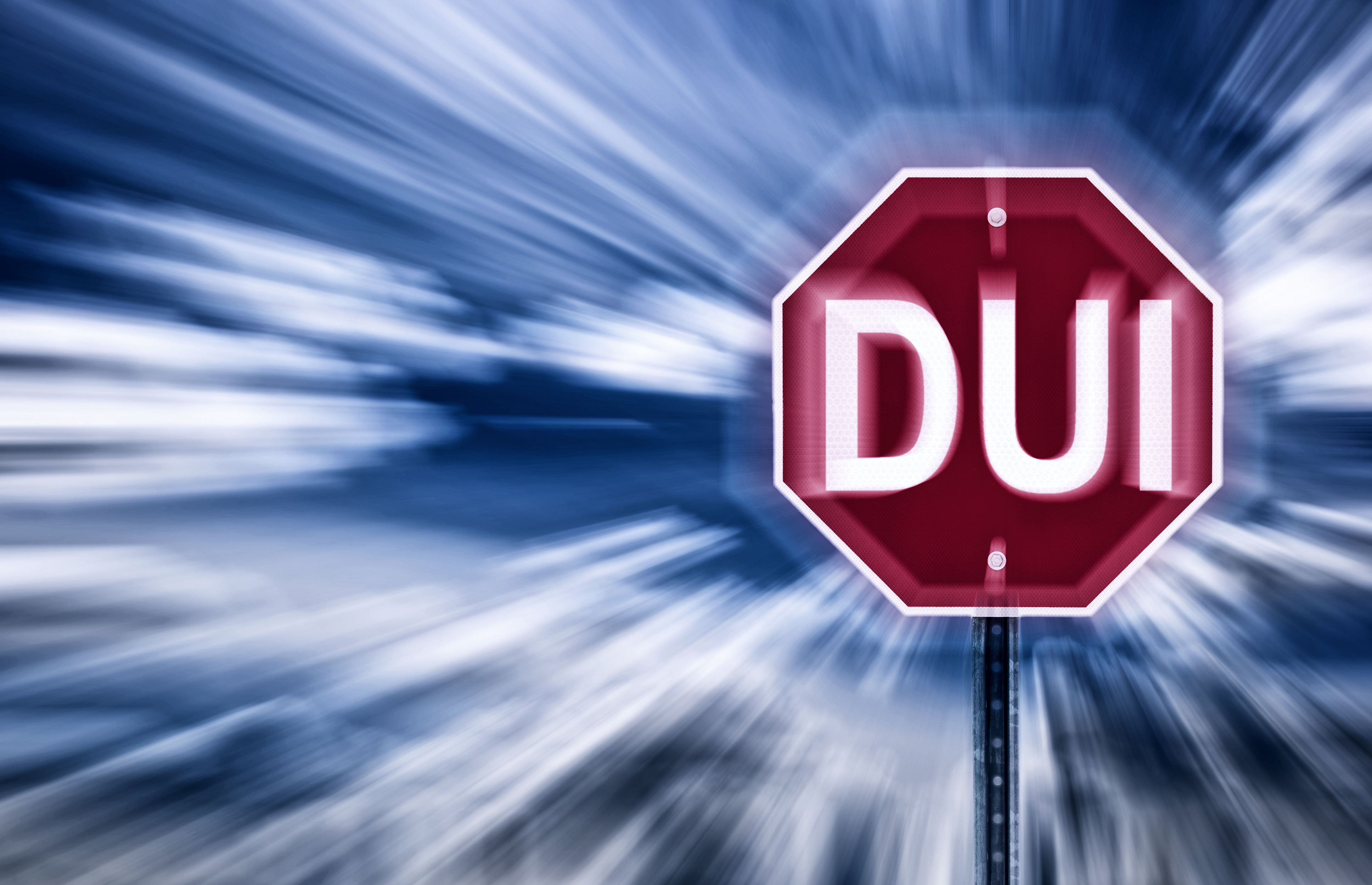 """The term """"DUI"""" on a stop sign"""