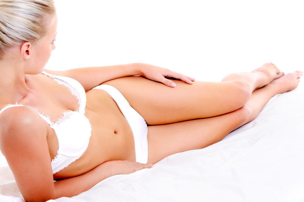 A woman in a white bra and panties