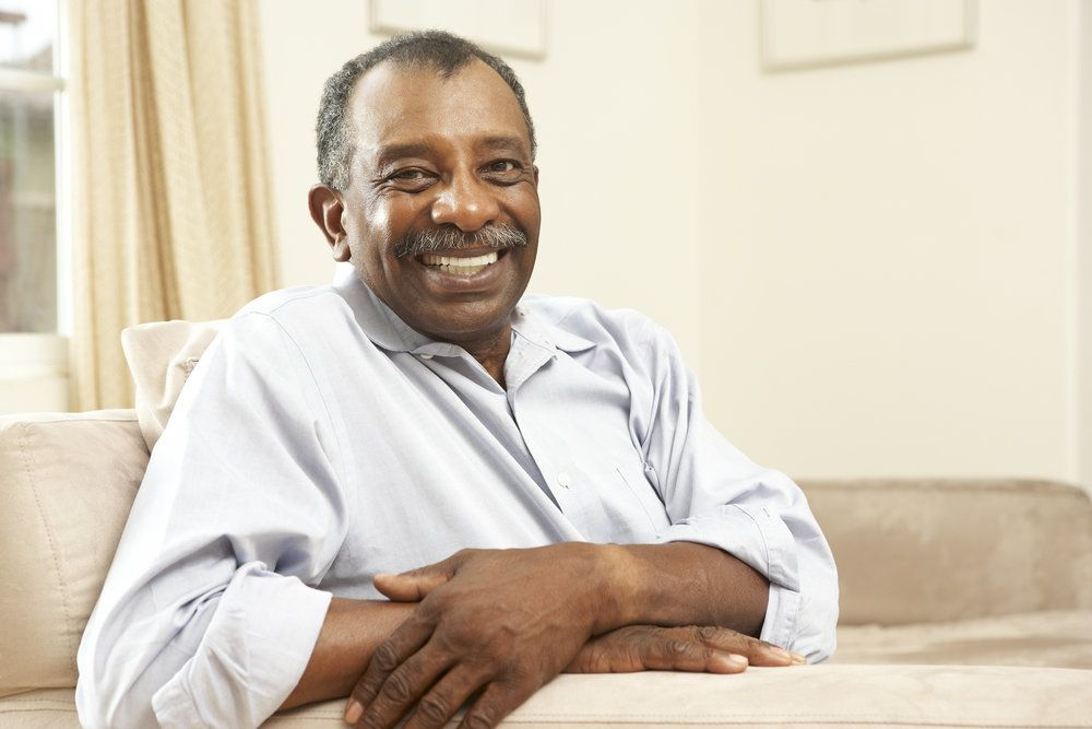 Man smiling broadly after receiving effective treatment for teeth grinding