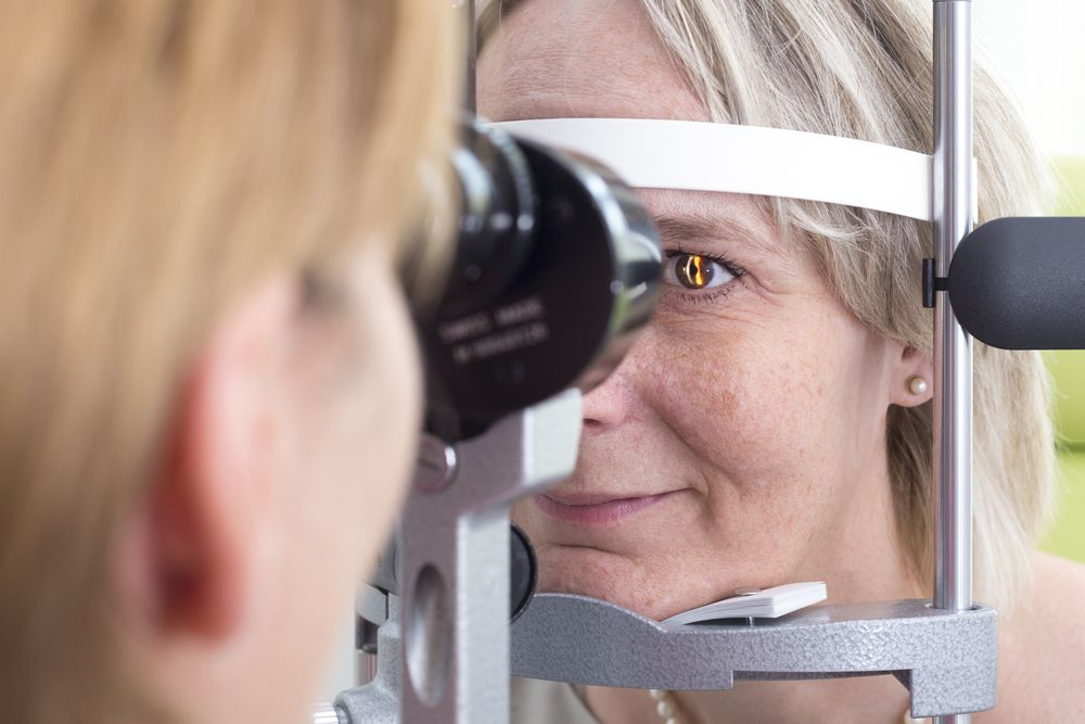 Female patient undergoing eye exam