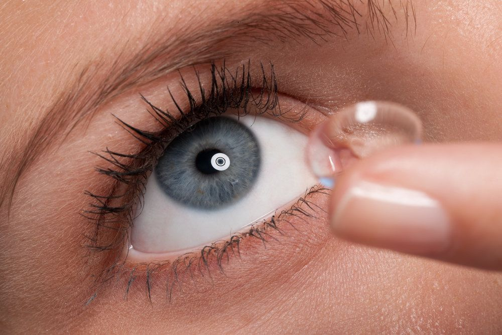 A woman inserting a contact lens