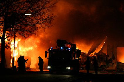 Firemen fighting an active blaze