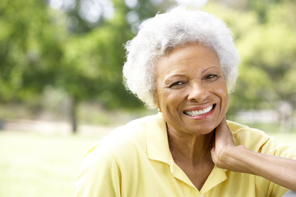A senior woman with a beautiful, healthy looking smile