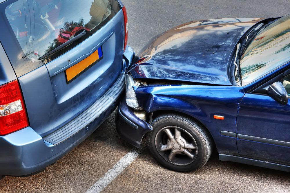 A rear end auto accident in a parking lot
