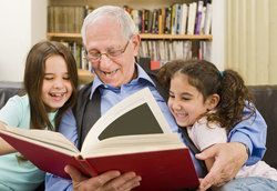 A grandfather reading to his grandchildren