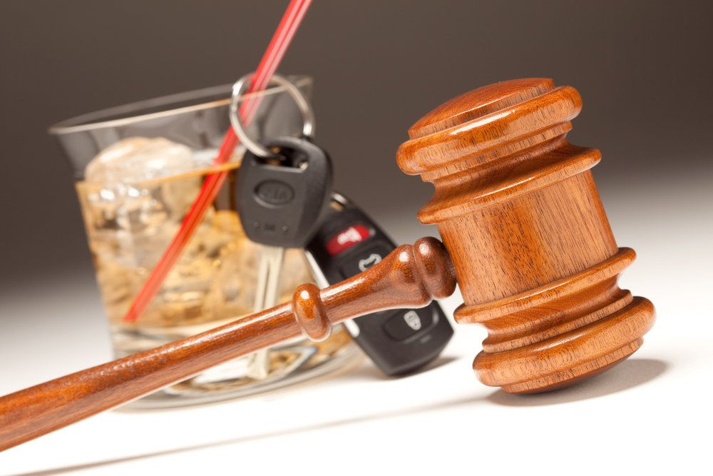 A gavel, a cocktail, and car keys