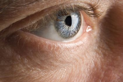 A closeup view of an elderly man's eye.