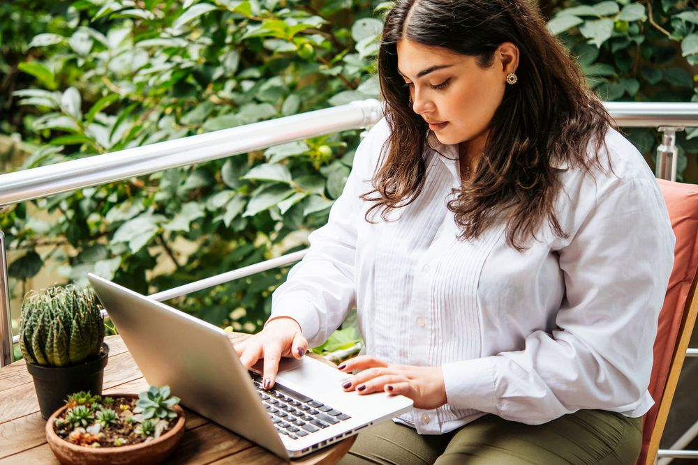 Woman outside on her laptop
