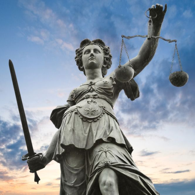A statue of justice and her scales
