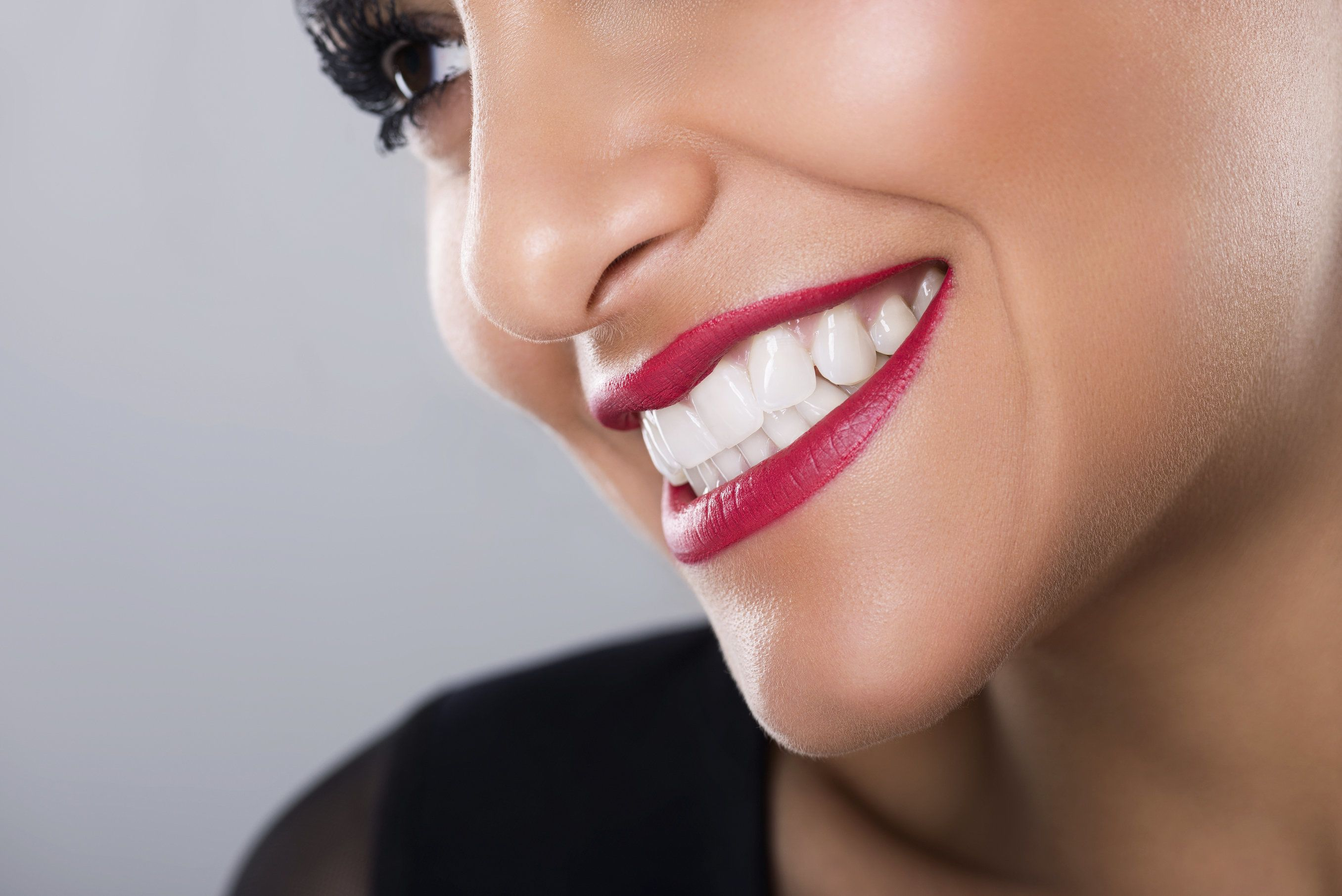 A woman with a beautiful smile after treatment for a twisted tooth