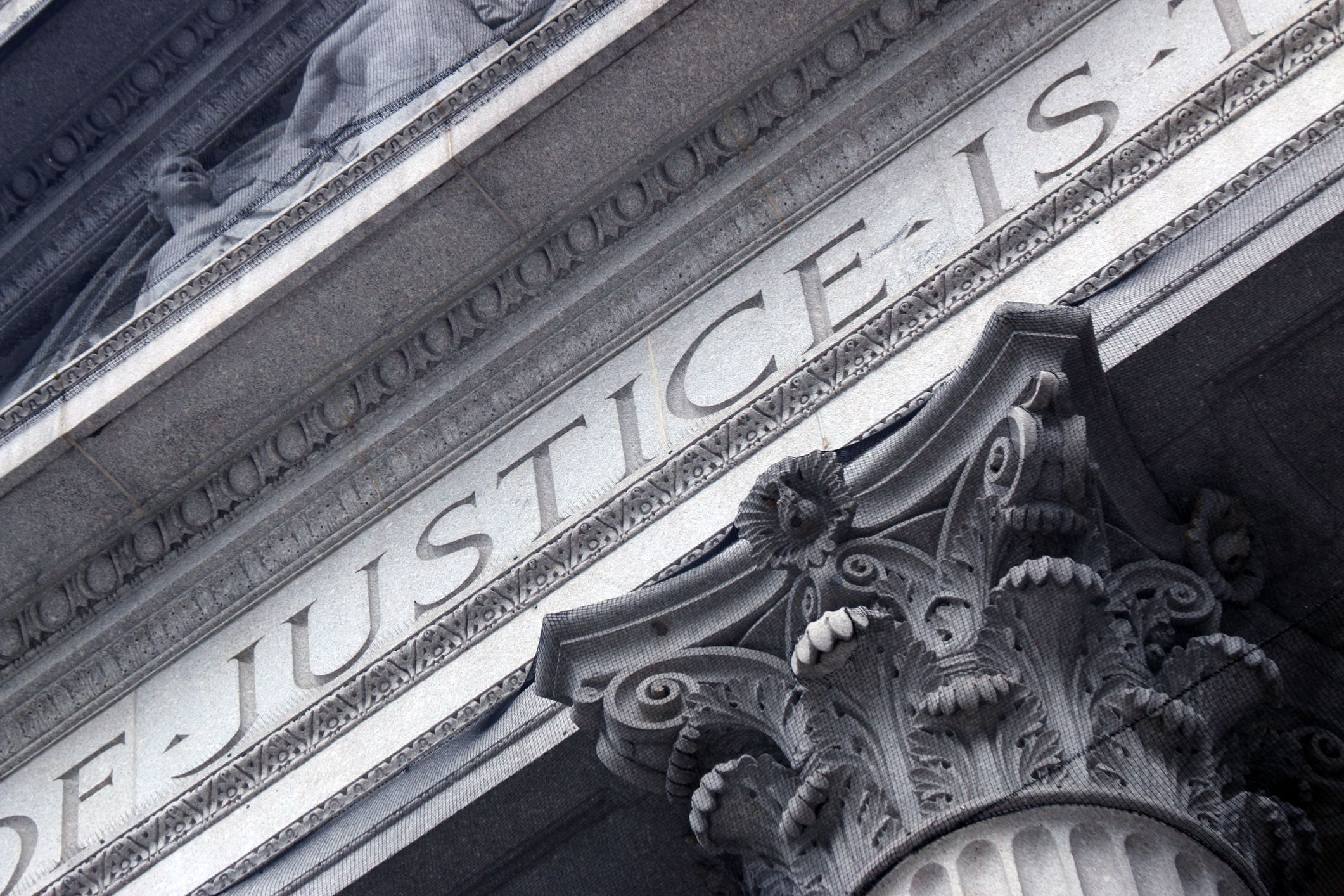 "A building with ""justice"" carved into its facade"