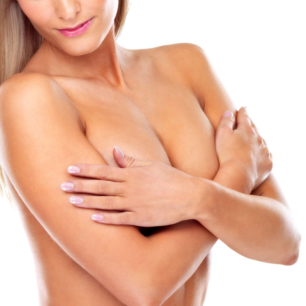 Photo of woman folding her arms over her breasts