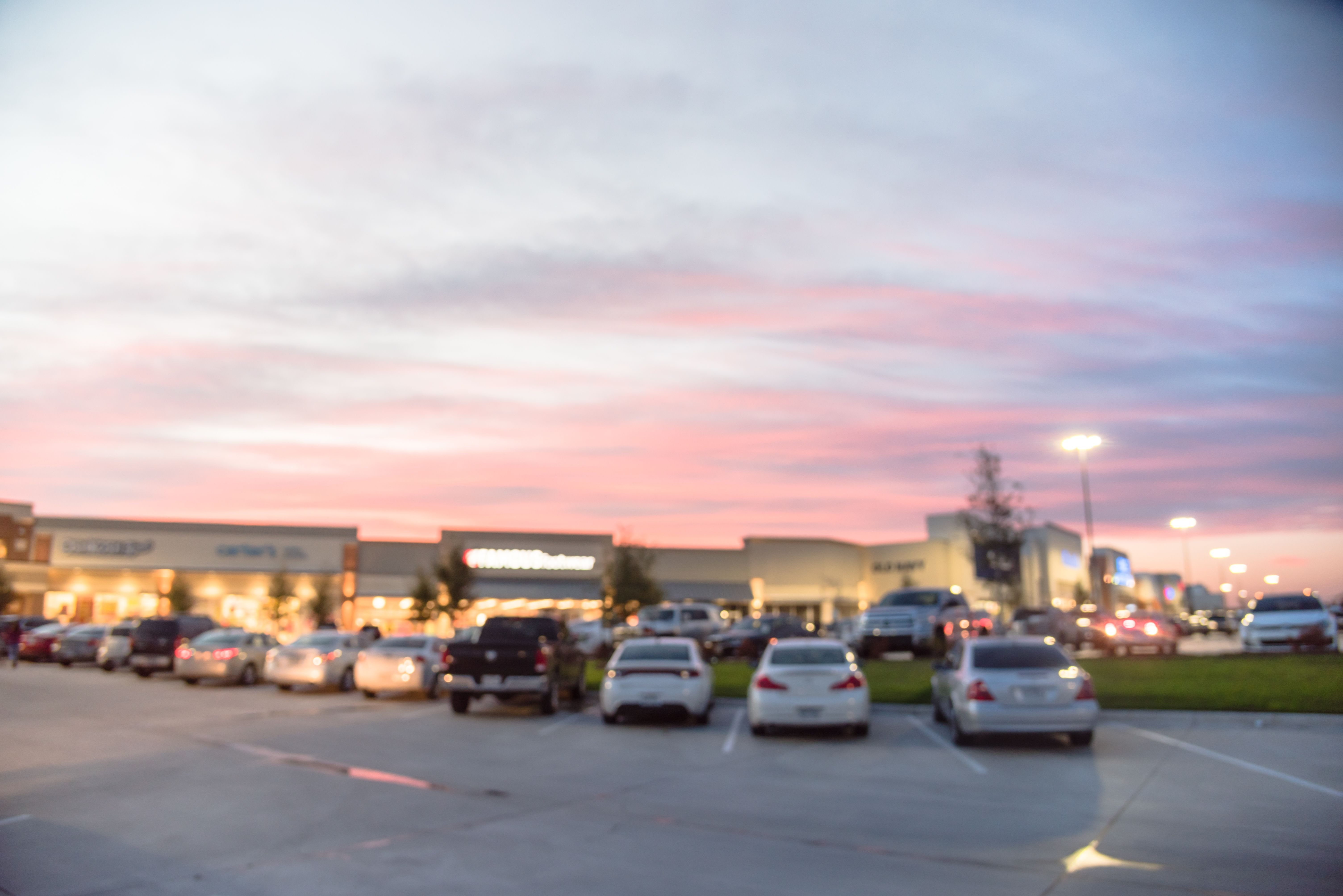 Shopping center parking lot at dusk