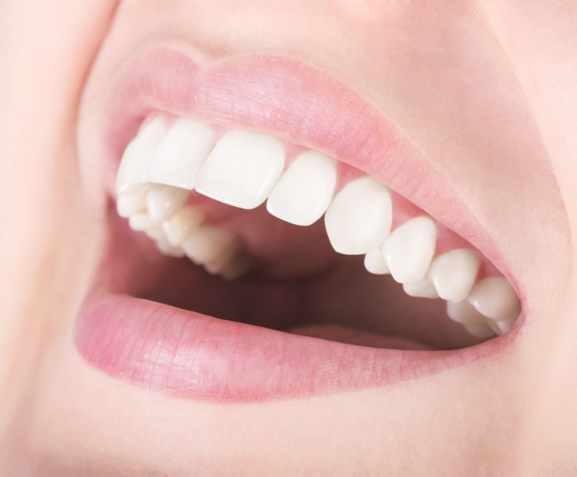 Closeup of smiling female mouth shows white and attractive teeth