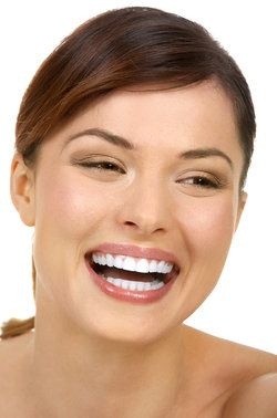 Laughing, attractive woman with very straight, white teeth