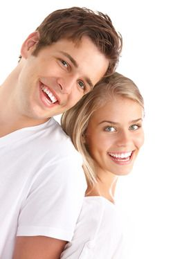 A man and woman with perfectly straight teeth showing off their stunning smiles