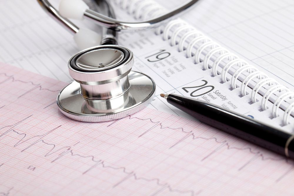 Stethoscope and medical charts