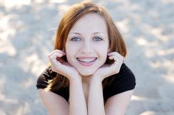 Smiling girl with red hair and braces