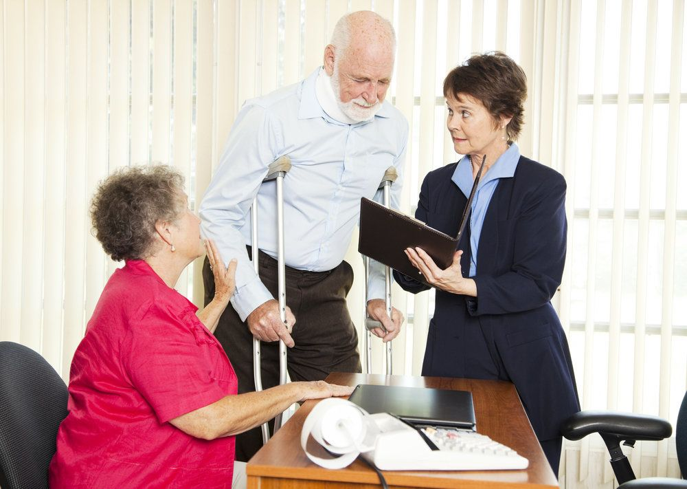 An injury victim speaks with an attorney