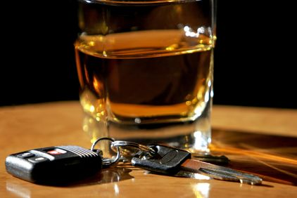 Glass of scotch next to car keys