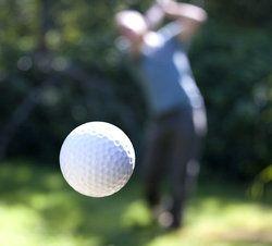 Golf Player Hitting a Ball