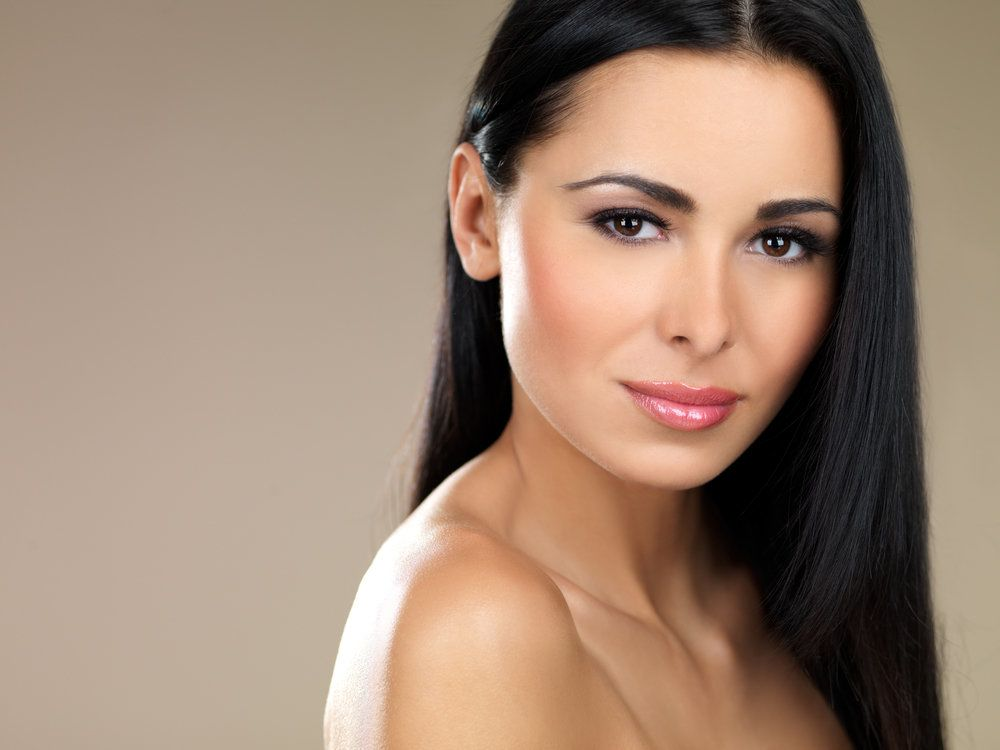 Woman with smooth, youthful facial features
