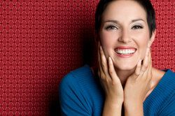 Laughing woman against red wallpaper