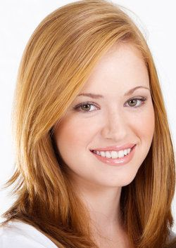 Attractive woman with strawberry blond hair and straight, white teeth