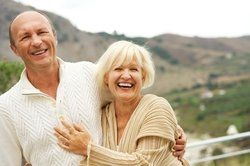 An older couple outdoors smiling