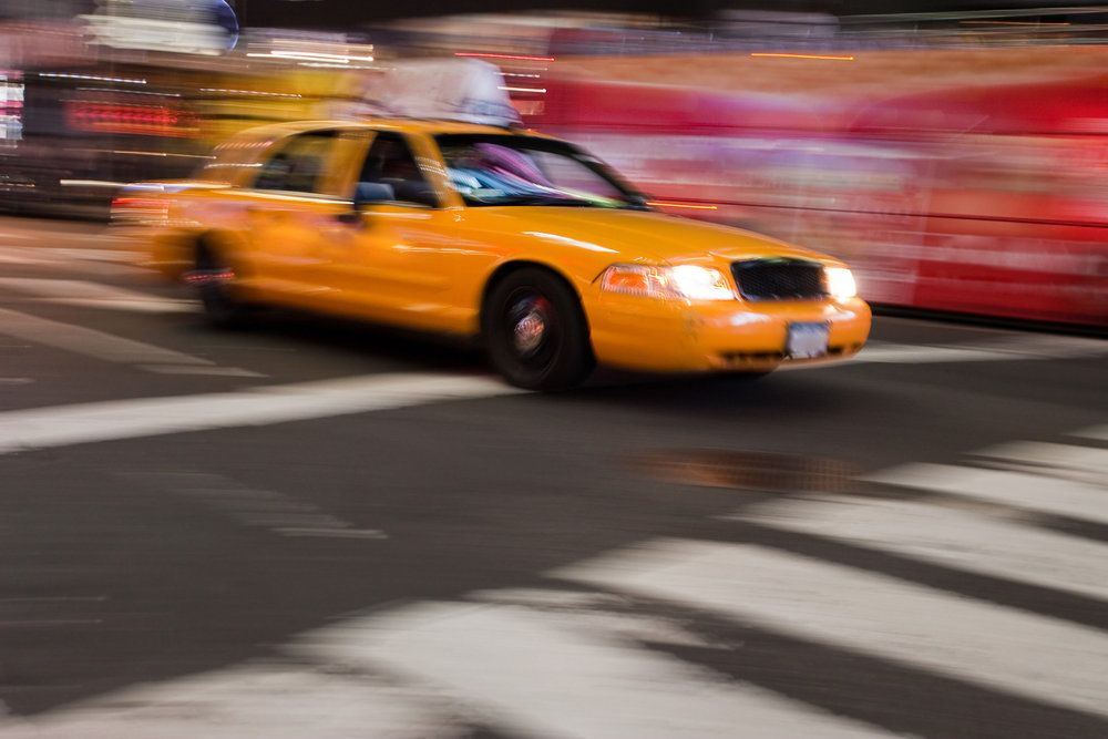 A taxi speeding down the street